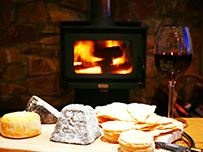 Cheese and wine platter in front of the wood fire